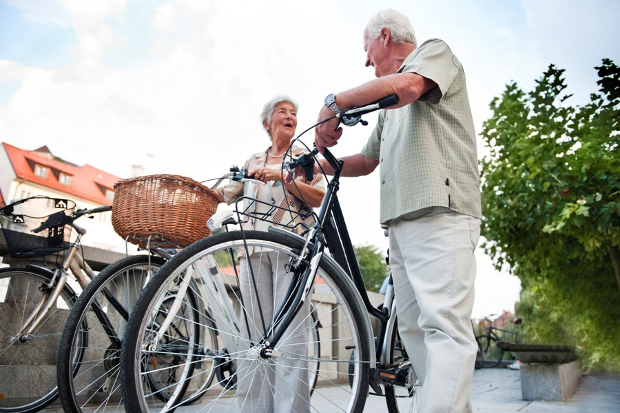 Older couple bike active shopping