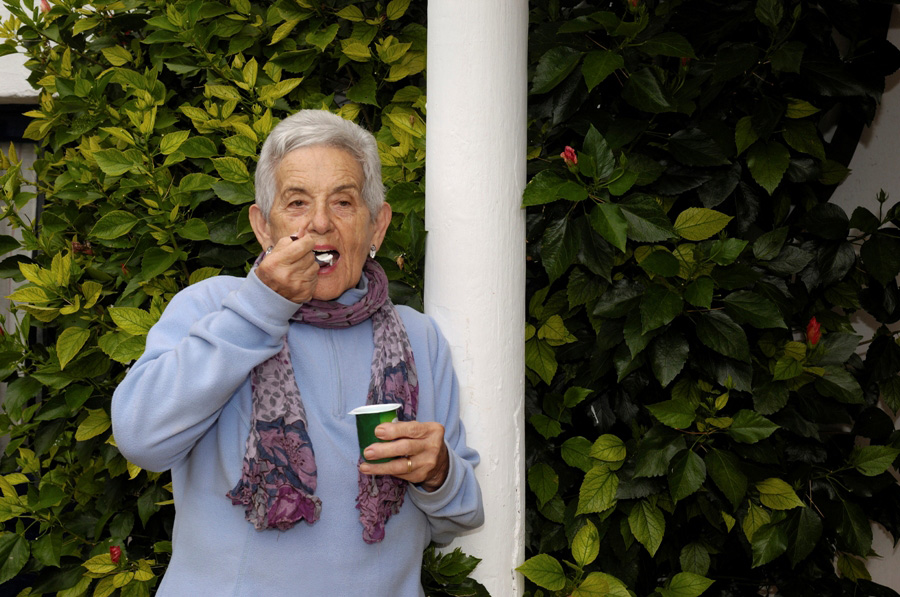 senior woman with yogurt,